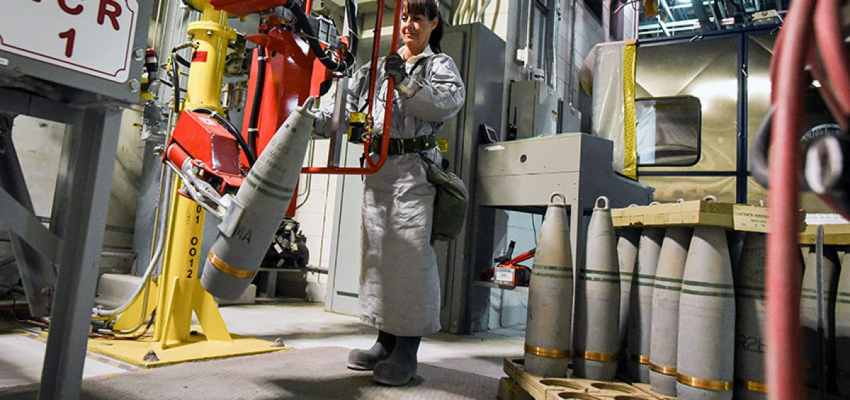 An ordnance technician uses a lift-assist device at the Pueblo Chemical Agent-Destruction Pilot Plant to place a 155mm projectile containing mustard agent onto a conveyor belt in the Enhanced Reconfiguration Building. Munitions are transported into the Explosion Containment Room for the removal of explosives. July 2020 saw the plant hit a new record number of munitions processed, with 15,400 155mm projectiles eliminated from the stockpile.
