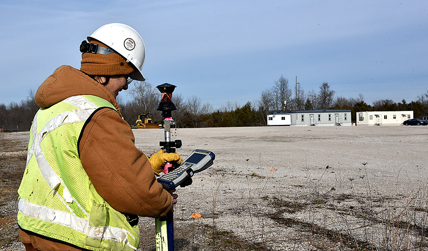 A surveyor performs initial mapping for the placement of storm sewers at the new Static Detonation Chamber 2000 site at the Blue Grass Chemical Agent-Destruction Pilot Plant. Work on the site began Jan. 22.