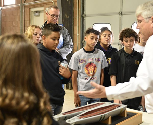 Pleasant View Middle School students, along with teacher Todd Seip, watch training specialist Kent Ladd point out the parts and contents of a chemical weapon during a Pueblo Chemical Agent-Destruction Pilot Plant Training Facility tour.