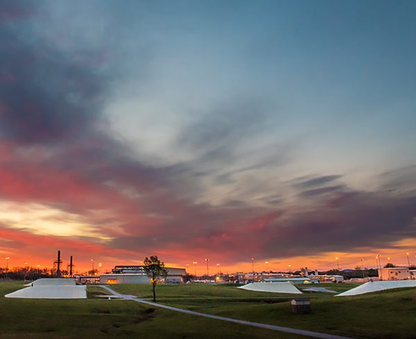 The sun rises over the Blue Grass Chemical Agent-Destruction Pilot Plant and munitions storage igloos on the Blue Grass Army Depot. The plant is hosting a public event May 29 to mark the start of chemical munitions destruction in Kentucky.