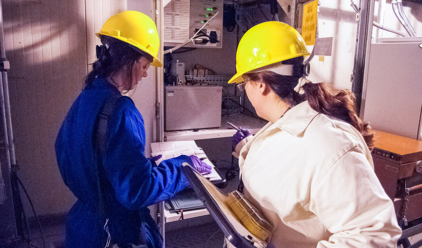 Monitoring technicians perform a challenge to air-monitoring equipment, known as MINICAMS, during the Agent Monitoring System Systemization Demonstration Test at the Blue Grass Chemical Agent-Destruction Pilot Plant.