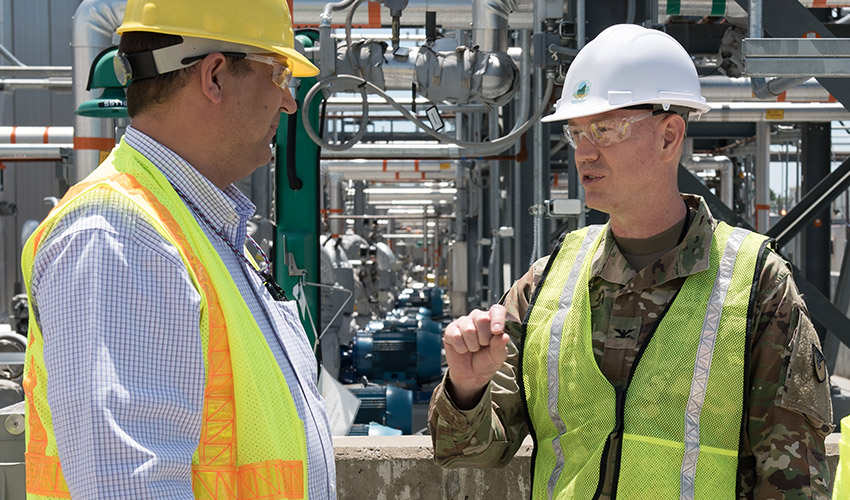 Col. Joseph Kurz, commander, Blue Grass Army Depot, discusses Blue Grass Chemical Agent-Destruction Pilot Plant processes with Ron Hink, project manager, Bechtel Parsons Blue Grass. The commander signed his acceptance of a Finding of No Significant Impact generated from a May 2019 environmental assessment for augmentation of plant processing capability July 1.