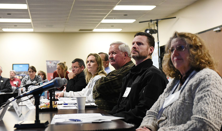 Attendees listen as Terry Staggs, plant support specialist, Bechtel Parsons Blue Grass, discusses the history of the Blue Grass Static Detonation Chamber at a public meeting Dec. 12.