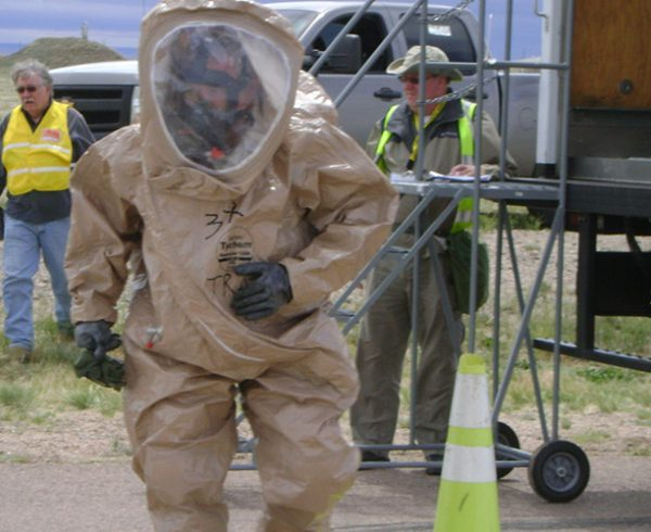 During a Chemical Stockpile Emergency Preparedness Program exercise held on May 8, 2019, a worker in a personal protective equipment suit practices emergency procedures during this annual event. This year, CSEPP exercise participants coordinated from the alternate Pueblo Community Joint Information Center site at the Pueblo Department of Health and Environment to test their ability to work from any location.
