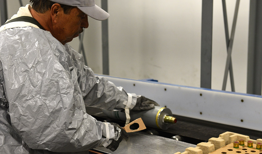 An ordnance technician at the Pueblo Chemical Agent-Destruction Pilot Plant reconfigures a 4.2-inch mortar round from its ready-to-use state to one ready for processing and destruction.