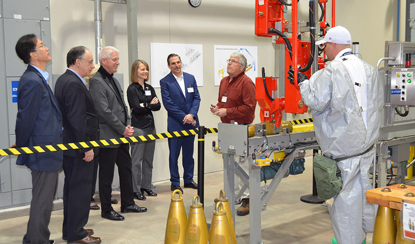 An ordnance technician demonstrates a lift assist at the Pueblo Chemical Agent-Destruction Pilot Plant Training Facility during the April 9, 2019, visit by members of the Organisation for the Prohibition of Chemical Weapons Executive Council.