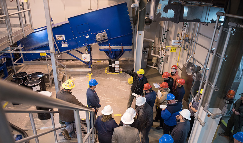 A plant support specialist explains Static Detonation Chamber details to Organisation for the Prohibition of Chemical Weapons technical officials at the Blue Grass Chemical Agent-Destruction Pilot Plant April 1.