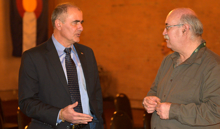 Michael Abaie, program executive officer, Assembled Chemical Weapons Alternatives, talks with Walton Levi, deputy site project manager, Pueblo Chemical Agent-Destruction Pilot Plant, during the January Colorado Chemical Demilitarization Citizens' Advisory Commission meeting.