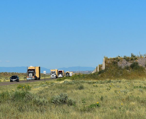 A convoy of semitrailers carrying components for the first Static Detonation Chamber travels Aug. 6, 2019, through the Pueblo Chemical Depot towards the SDC construction site at the Pueblo Chemical Agent-Destruction Pilot Plant. Three SDCs will be used in the Pueblo plant's mission to destroy the remaining chemical weapons stockpile in Colorado.